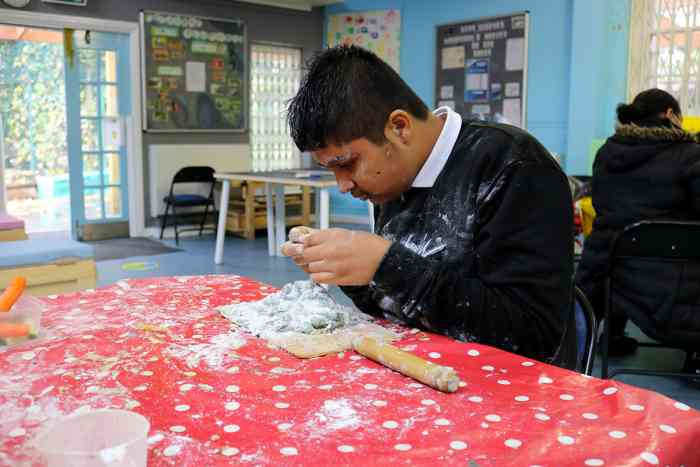 Young person baking during Teenscheme at The Limes